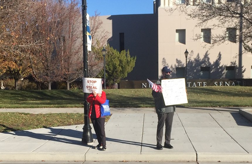 2 People stand in front of Carson City Capitol on 11/23/2020 in support of STOP THE STEAL